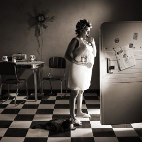 Woman raiding the fridge in the middle of the night